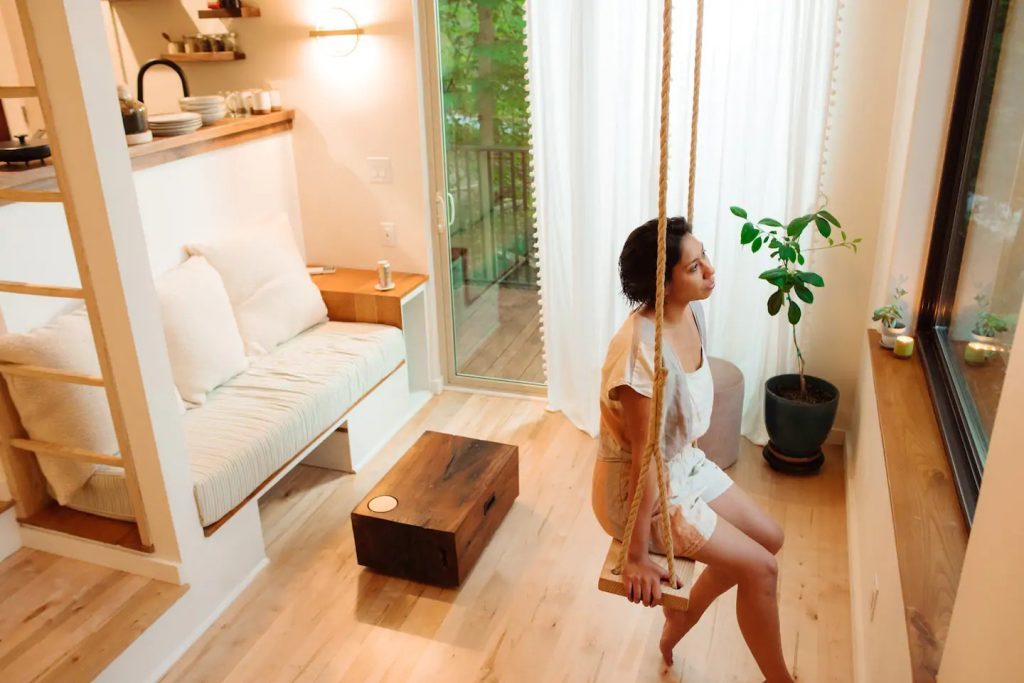 Indoor swing in living space with woman