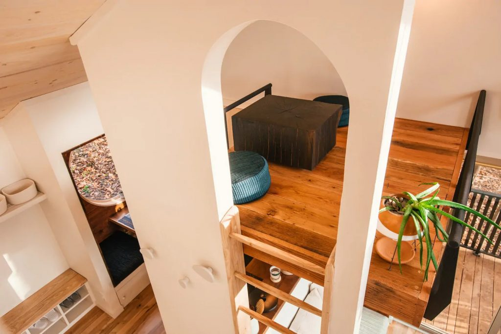 Arched opening by ladder in tiny loft
