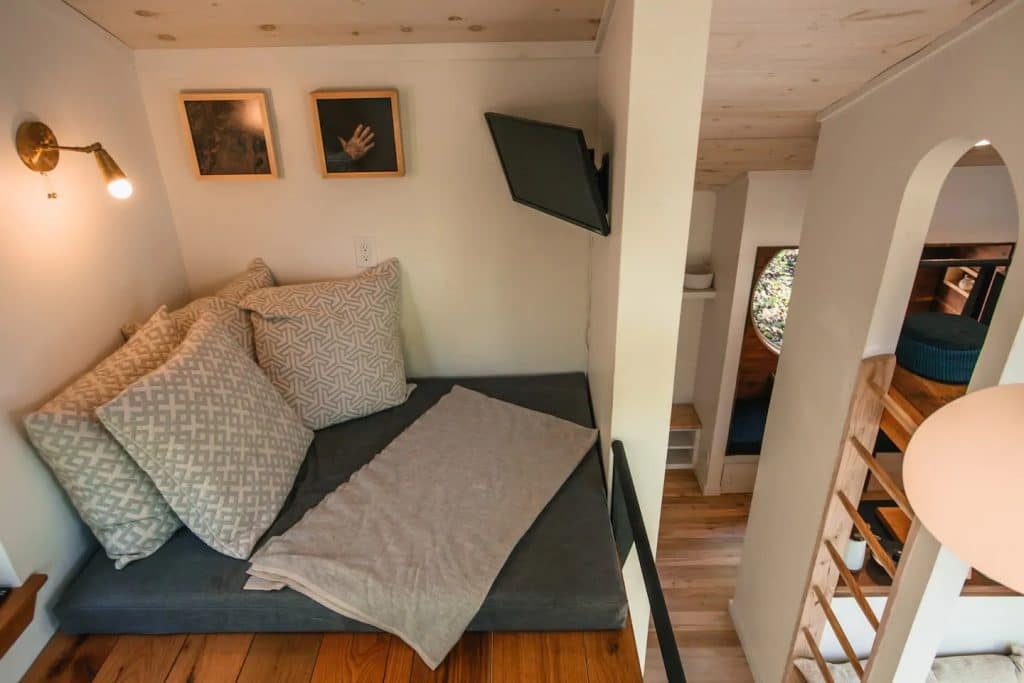 Sleeping nook with large grey pillows