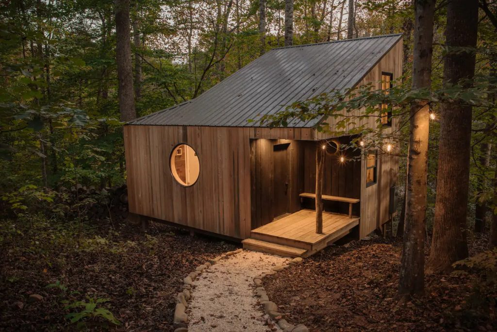 The Nook tiny house cabin with round window