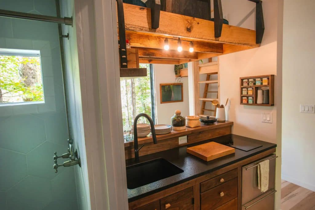 Tiny house kitchen with large sink and dark cabinets