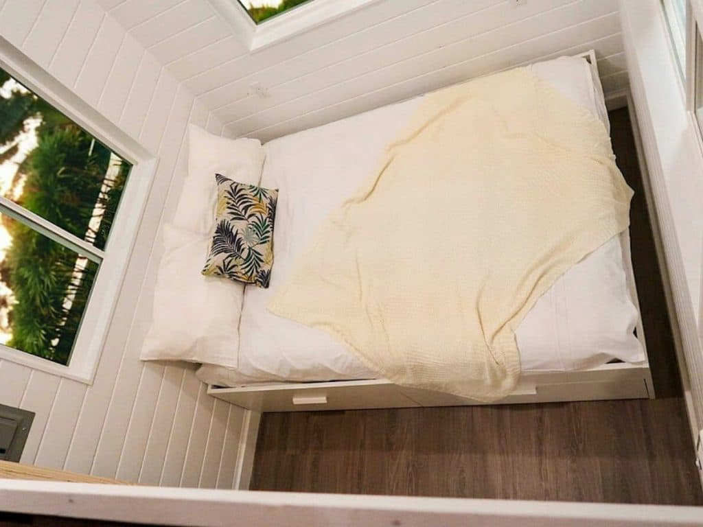 Bed in tiny house bedroom