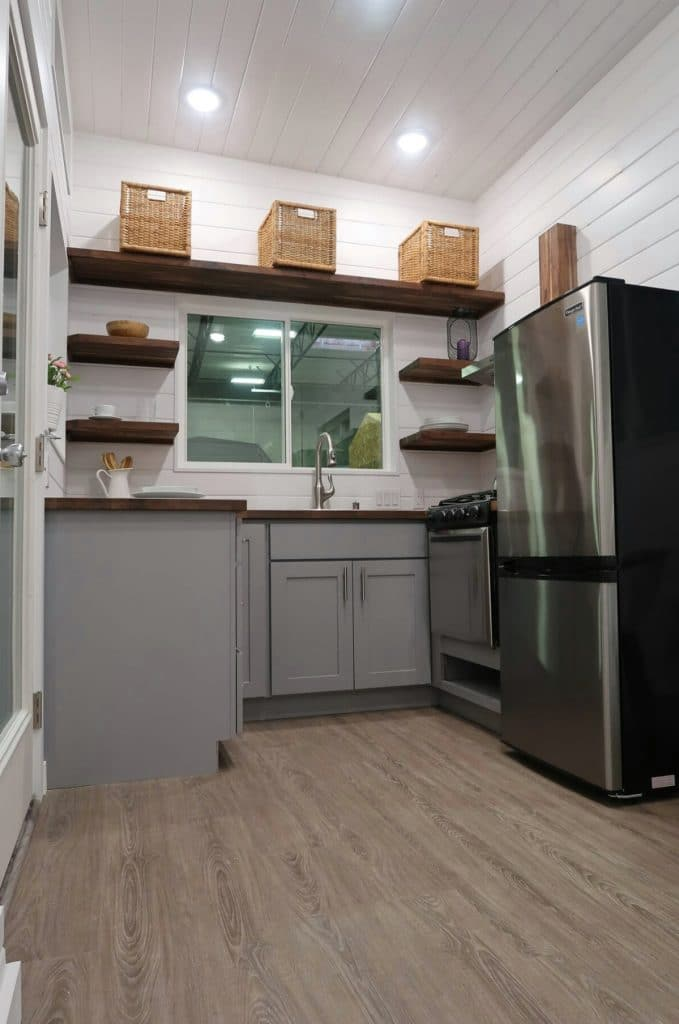 Tiny house kitchen with stainless steel appliances