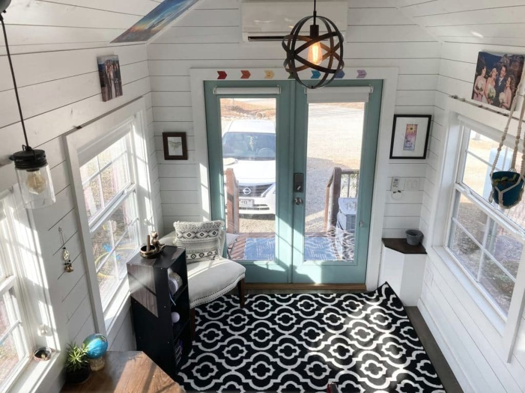 Tiny home living space with black and white patterned carpet