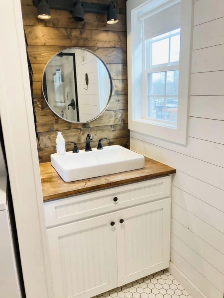 White vanity cabinet with weathered wood background