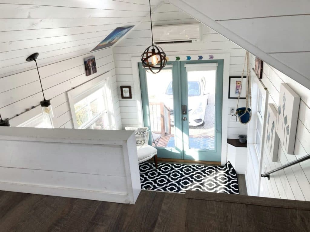 View down from loft with white shaplap partial wall