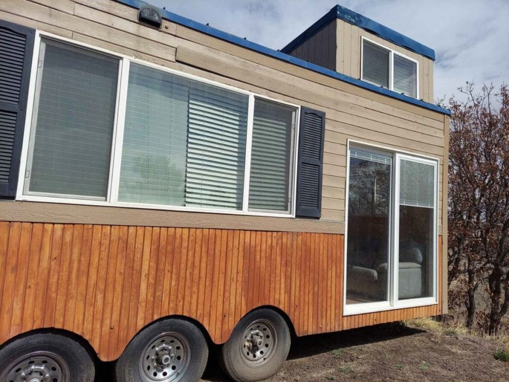 Two toned tiny house with sliding glass doors