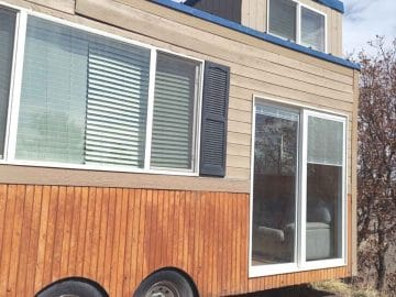 Tiny house with loft and two tone siding