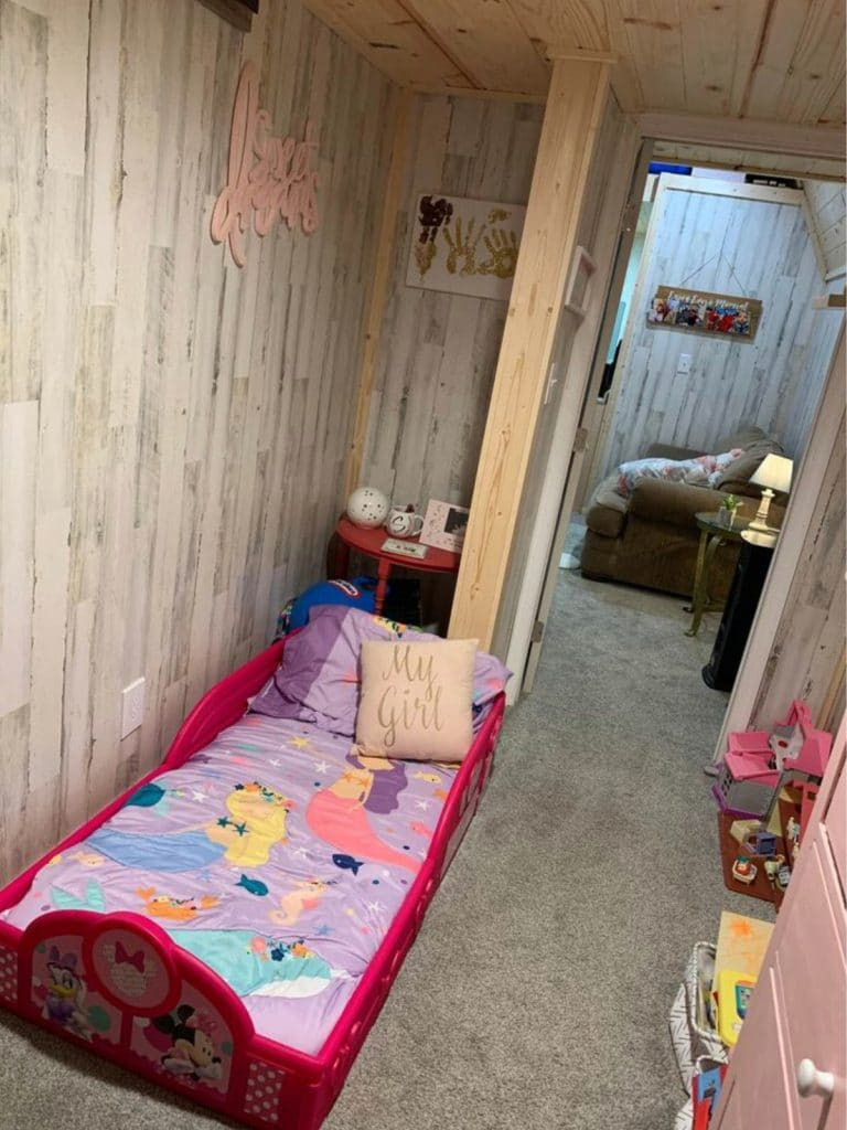 Pink toddler bed in small room