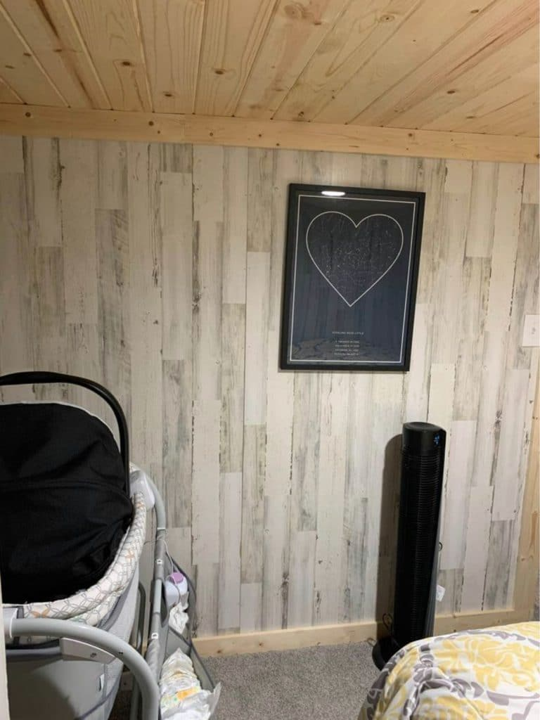 Decor on wall of tiny bedroom near air purifier