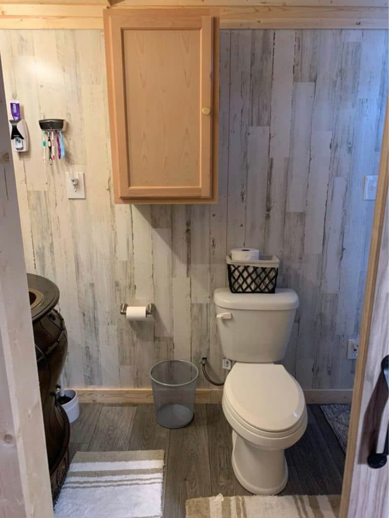 Toilet against wall in bathroom