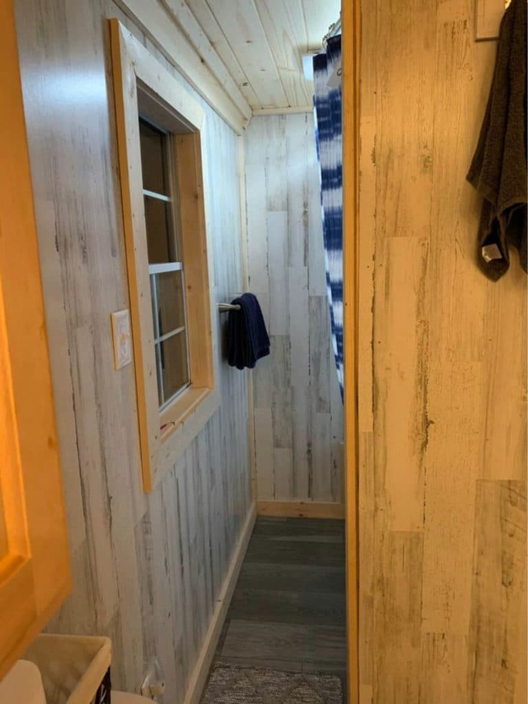 Hall leading to bathroom shower