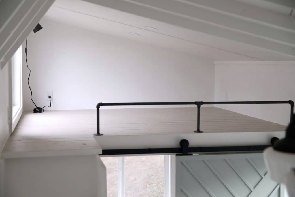 Loft above bathroom with window on one side