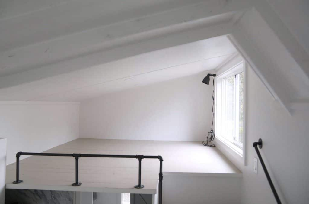 Angled ceiling in loft space with white walls