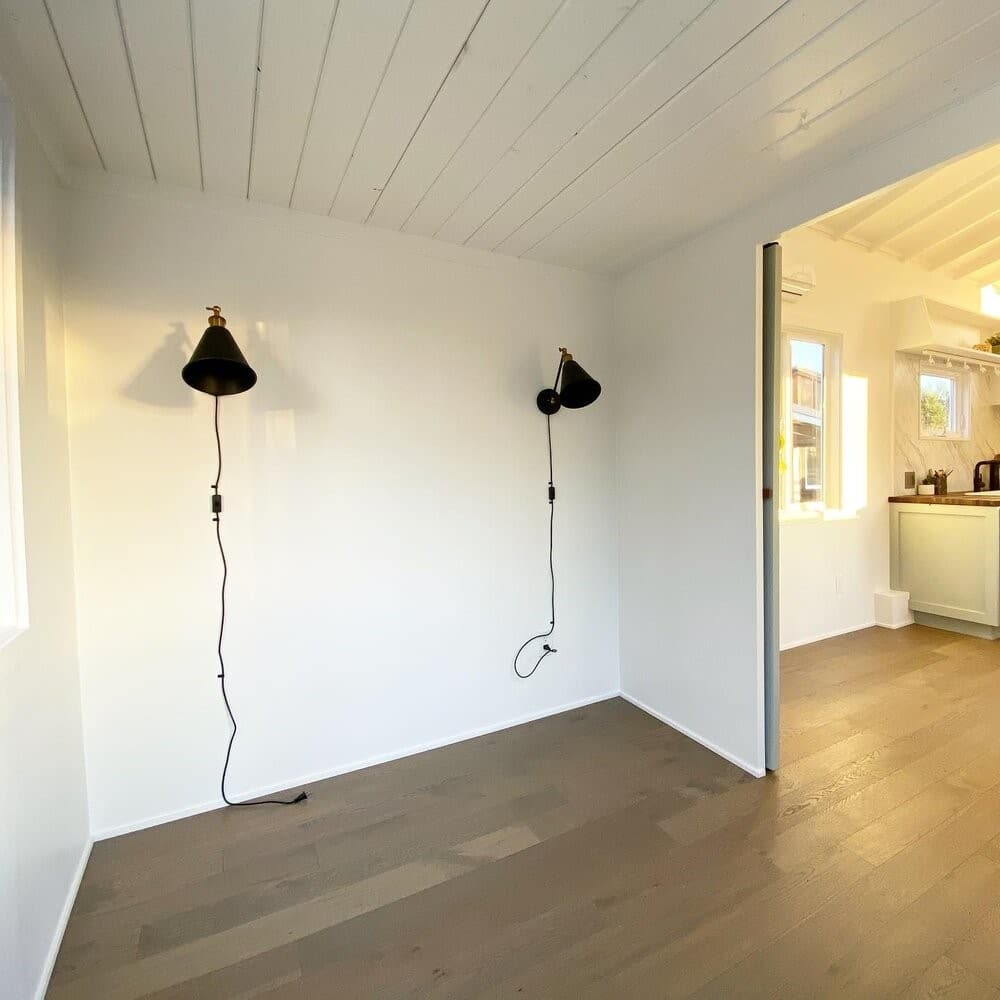Black lamps on bedroom wall