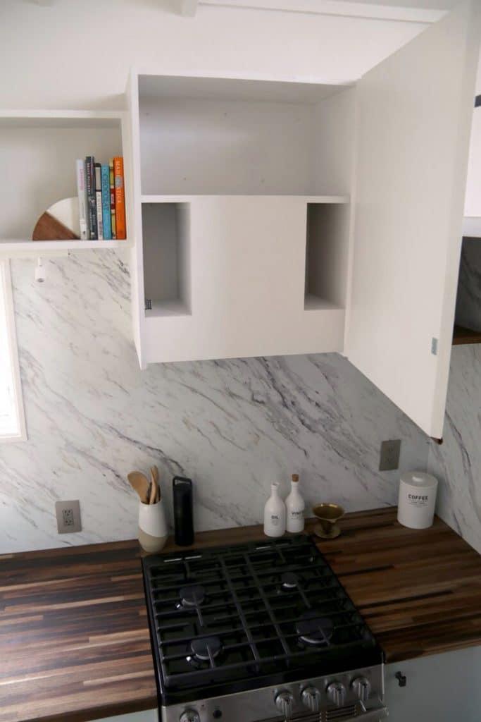 White cabinet above gas stove