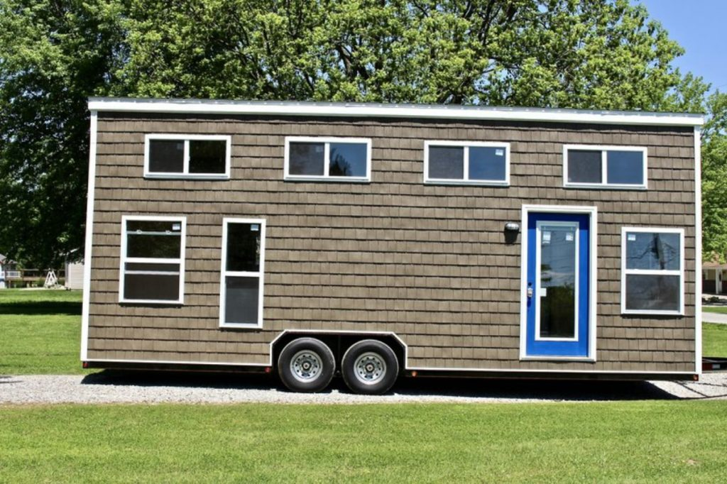 Tiny house on driveway with blue door