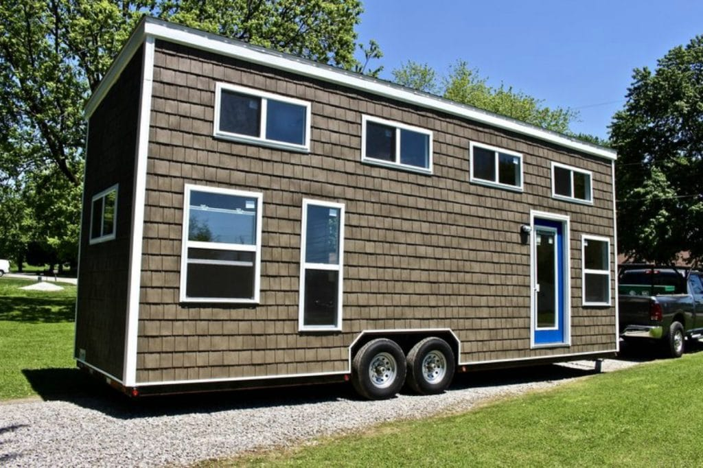 Brown tiny house with blue door