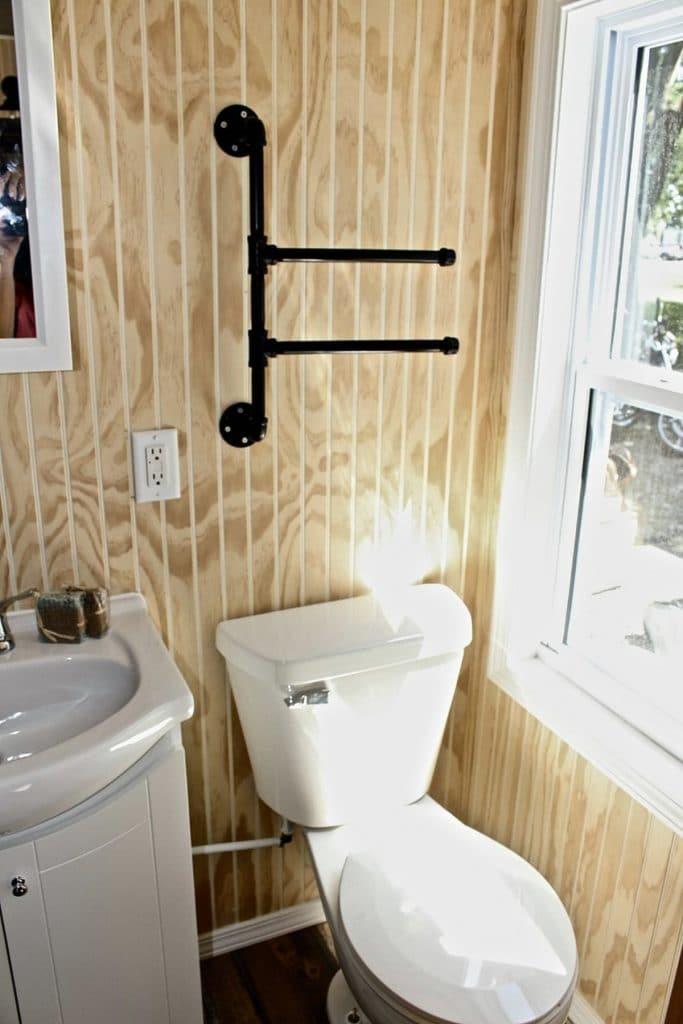 Towel hanger above toilet