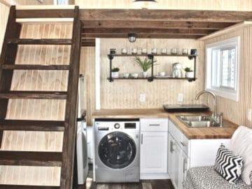 Farmhouse tiny home kitchen with dark wood ladder