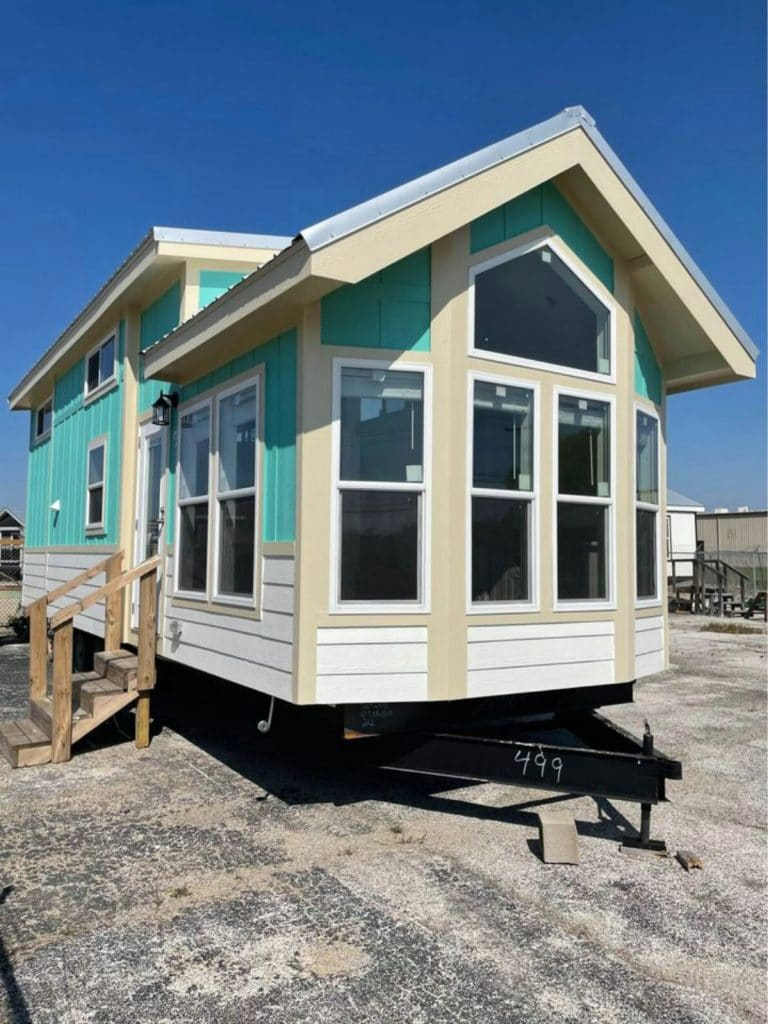 Front of tiny house with teal siding
