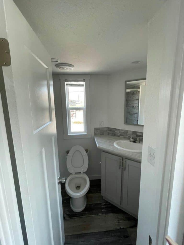 Open door looking into tiny bathroom