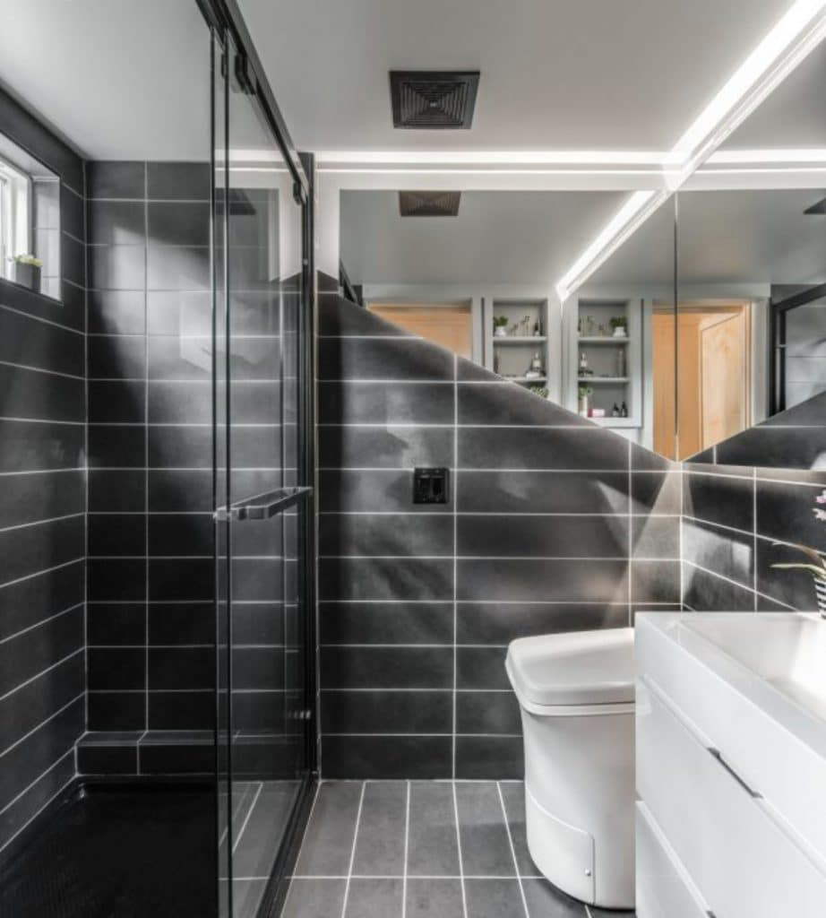 Charcoal tile bathroom with white ceiling and white toilet
