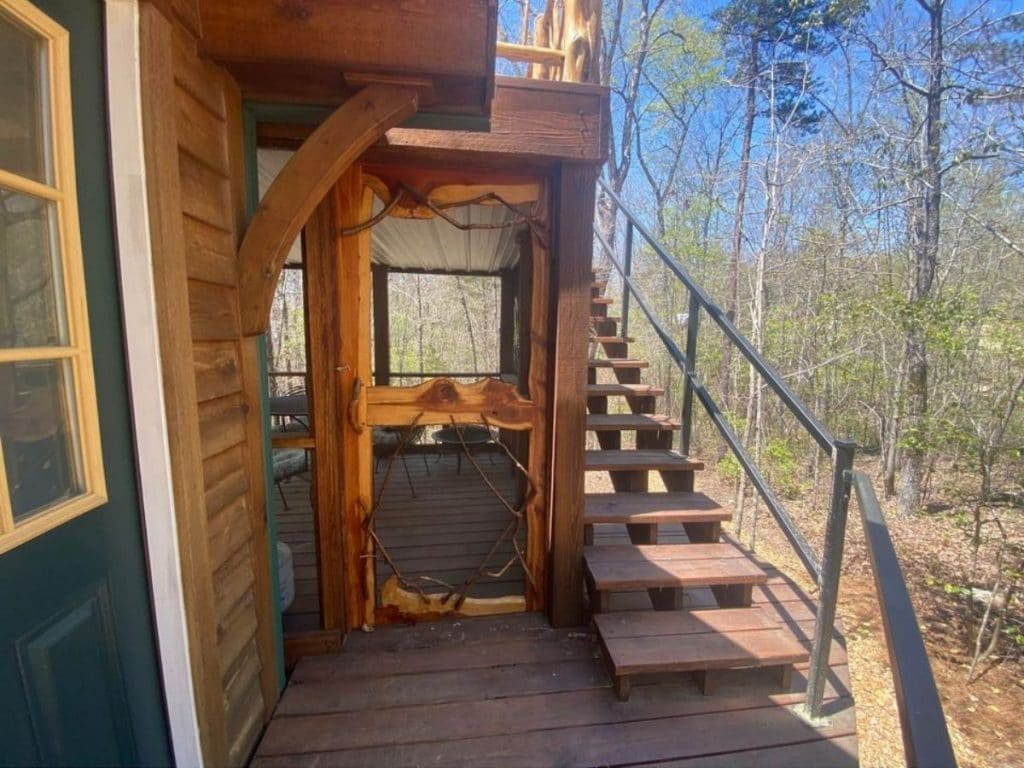 Wooden screen door into enclosed porch