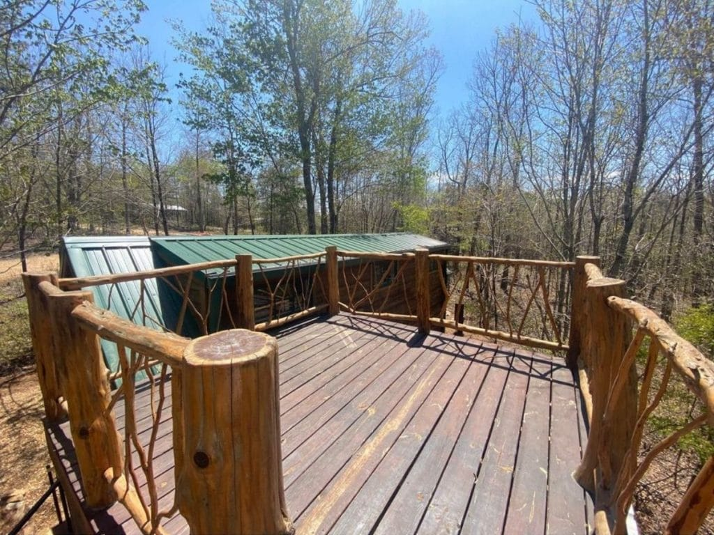 Deck overlooking green roof of tiny house