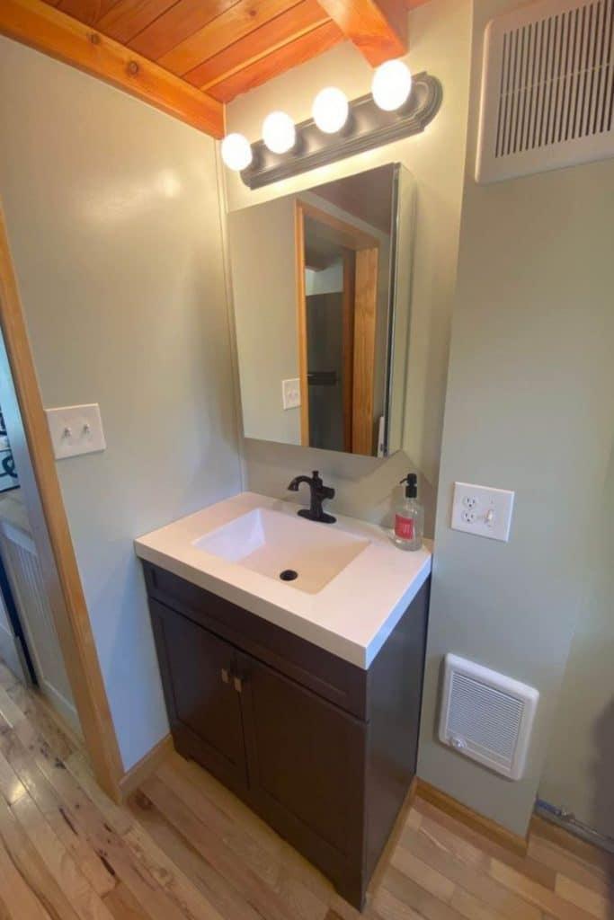 Modern vanity with a dark bottom and white sink