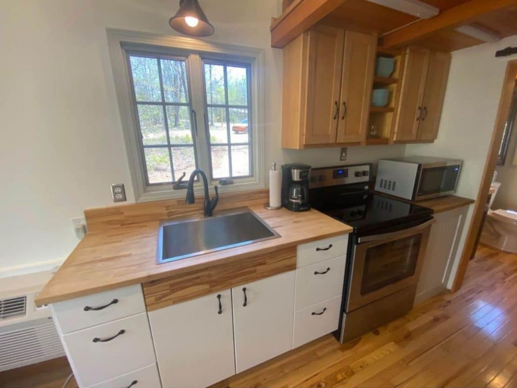 Kitchen with stainless sink and black stove