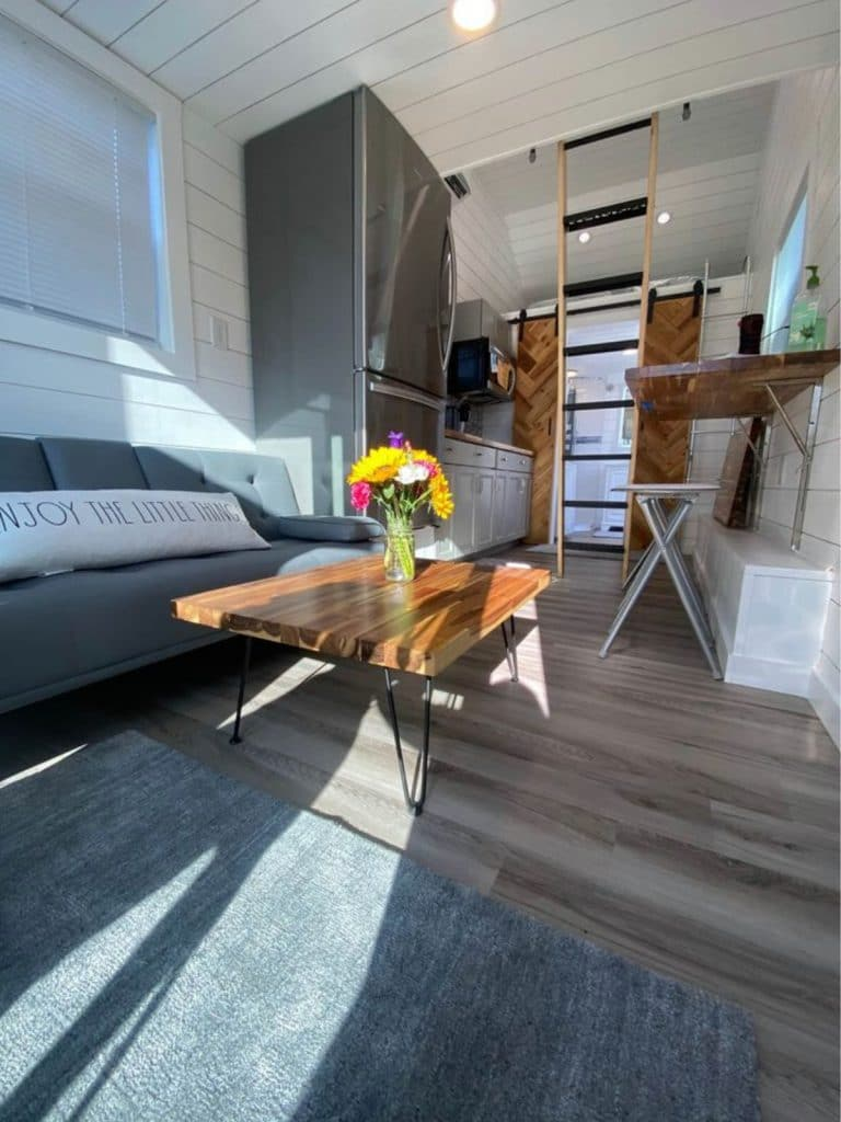 Living space in tiny house with wooden table