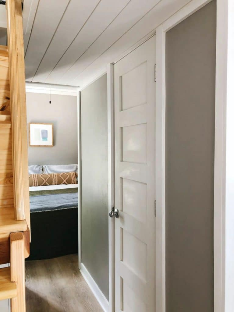 View of hallway in tiny house looking into bedroom