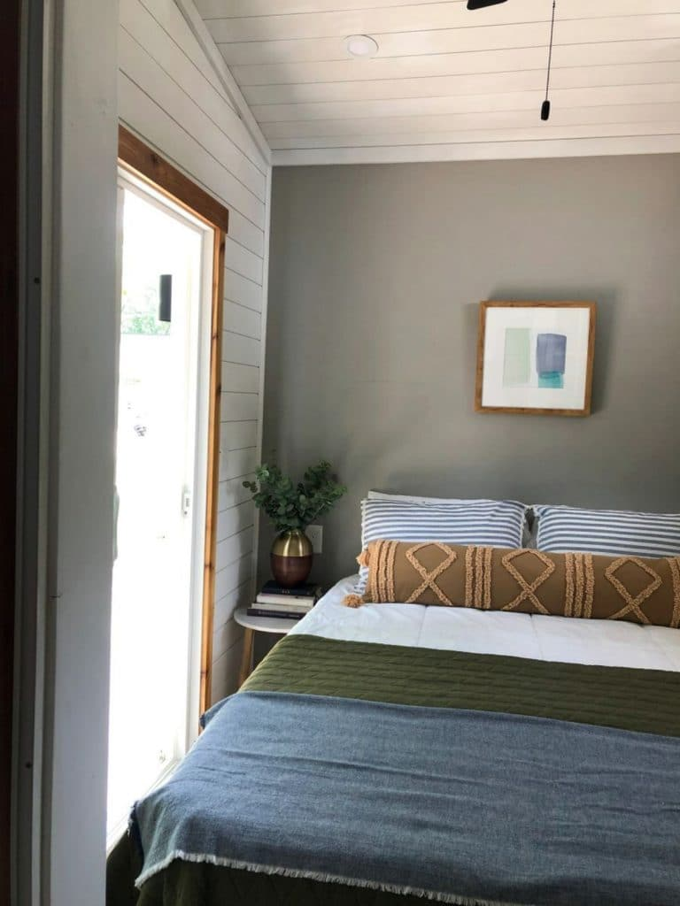 Blue bed against gray wall with sliding door