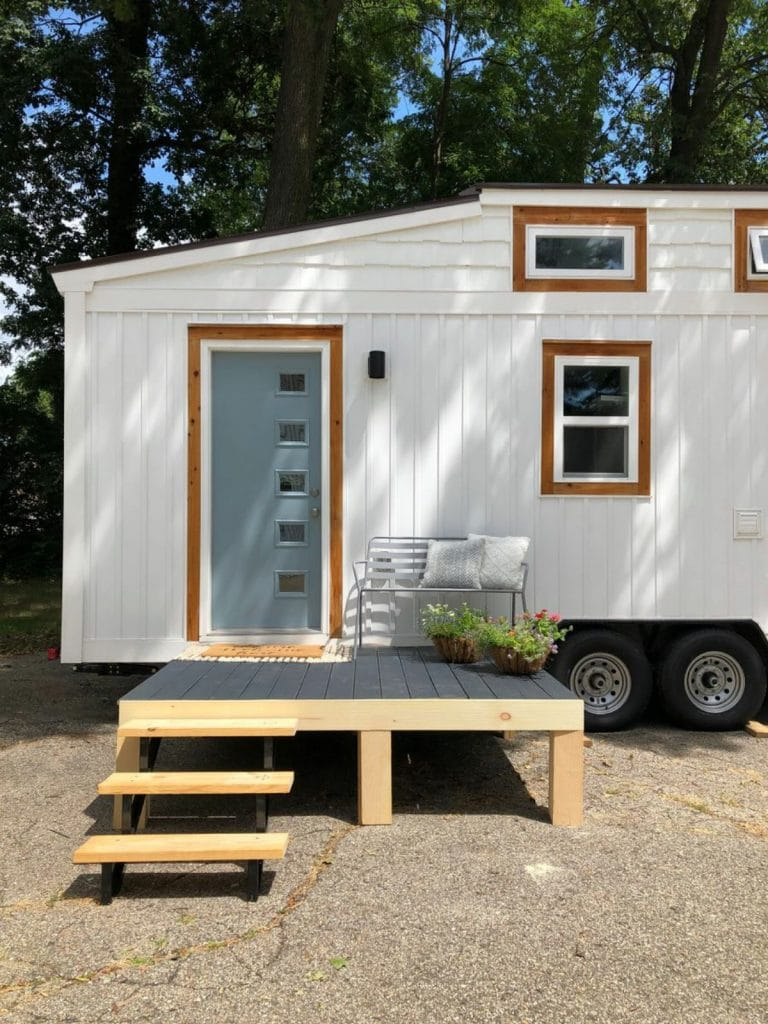 Small wood porch without rail by tiny home