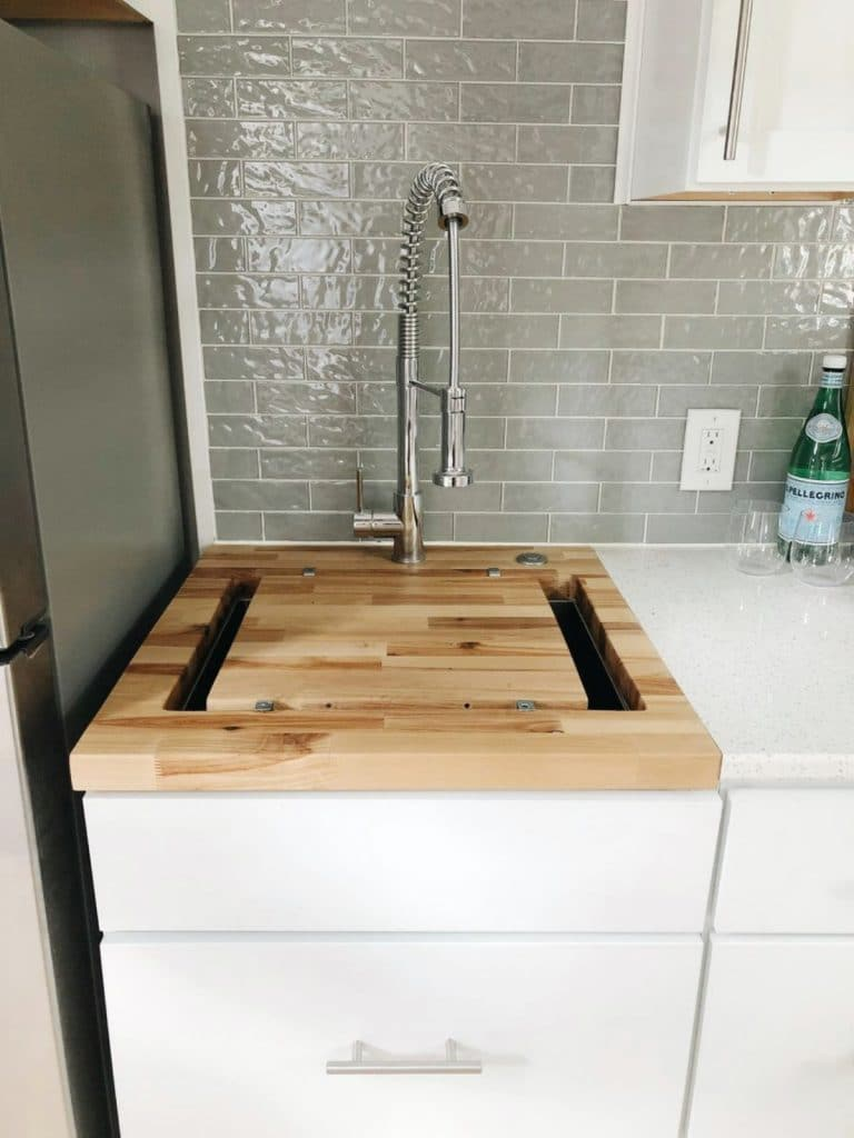 Kitchen sink with butcher block inset