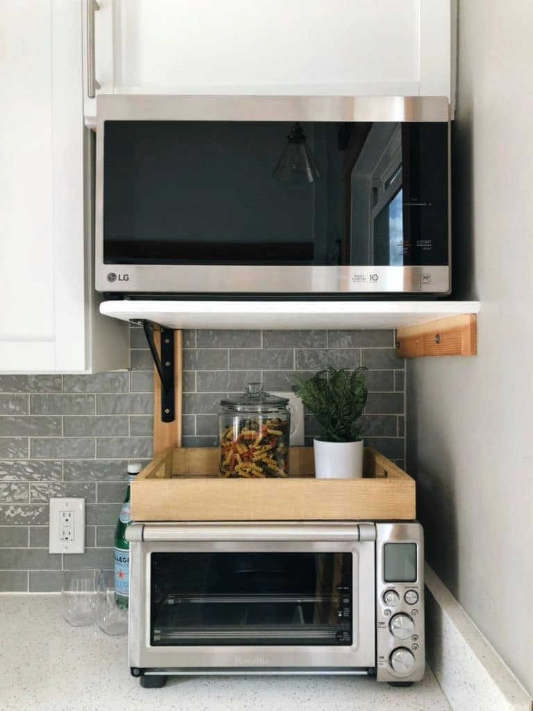 Microwave on wall above toaster oven