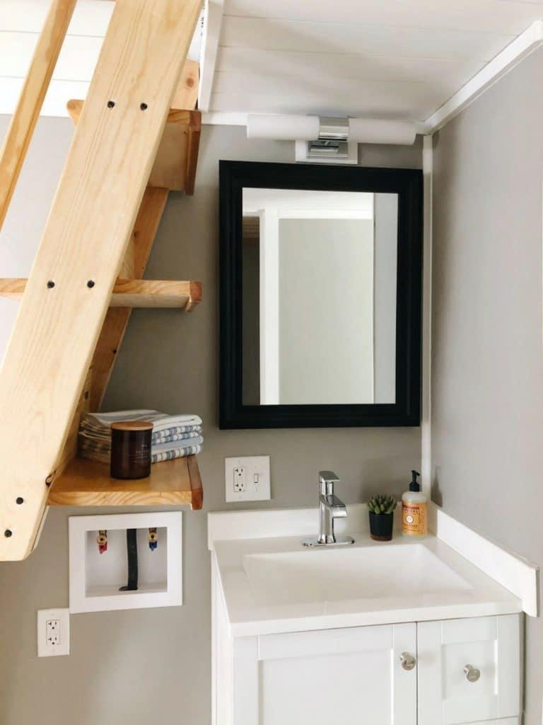Bathroom vanity with mirror and dark trim