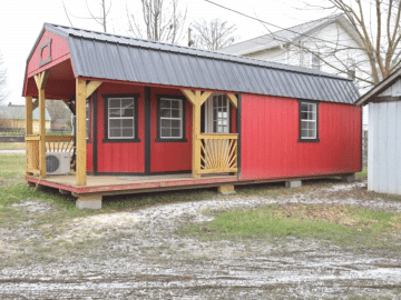 Side of red tiny home that looks like a shed