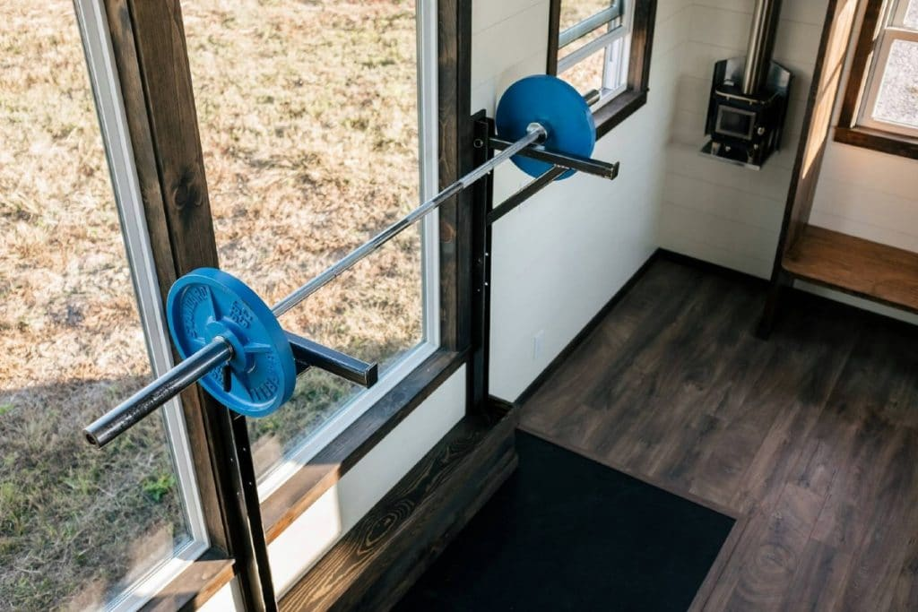 Squat bar next to large window