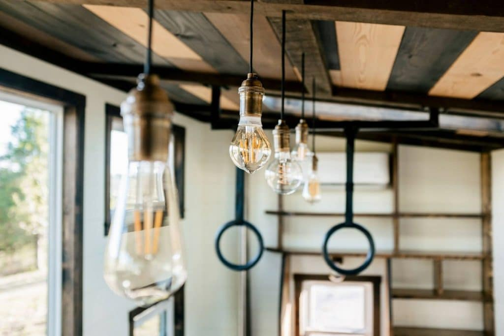 Edison lights hanging from reclaimed wood ceiling