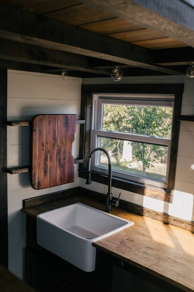 Deep white farmhouse sink in butcher block counter