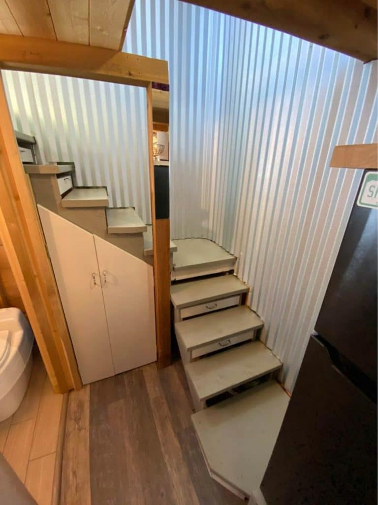 Stairs with corrugated metal wall leading to loft