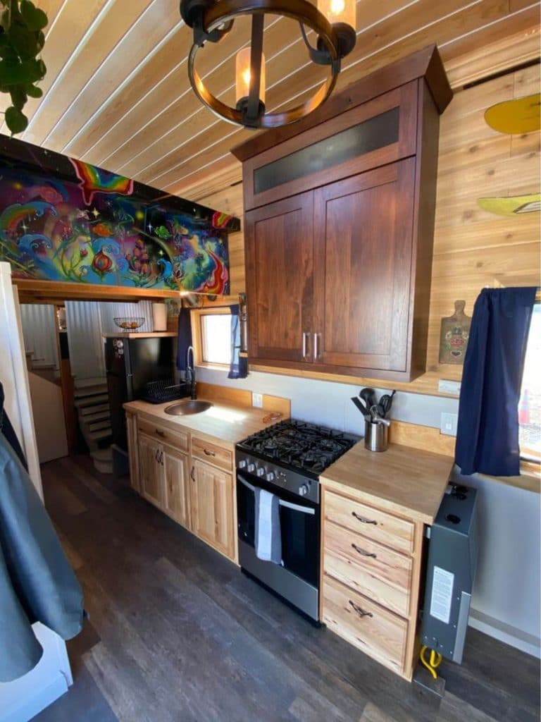Tiny house kitchen with full range and refrigerator
