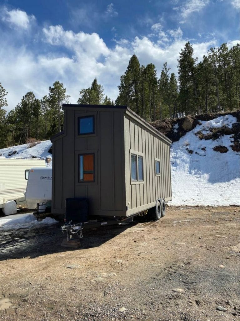 Grey exterior on tiny home with solar power