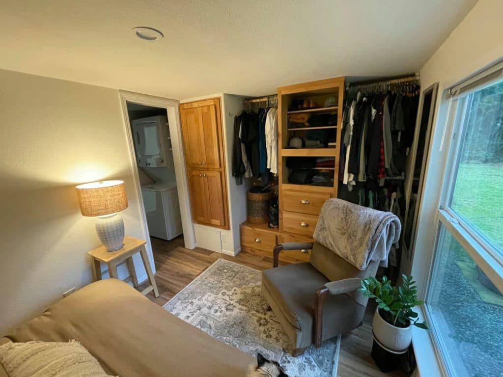 Bedroom with wall of shelving and closet rods