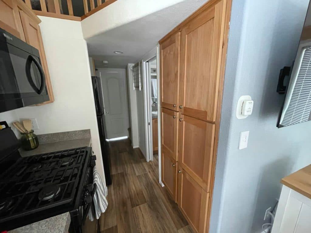 Hallway in tiny house with wood linen cloet doors