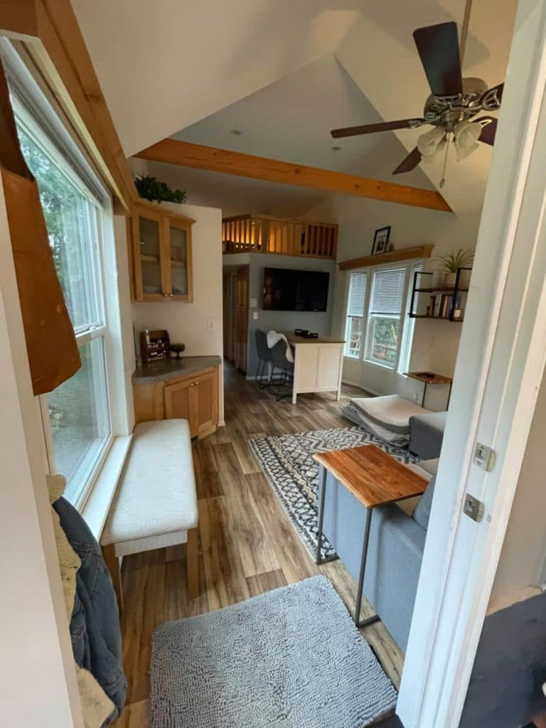 View into tiny living space with window bench