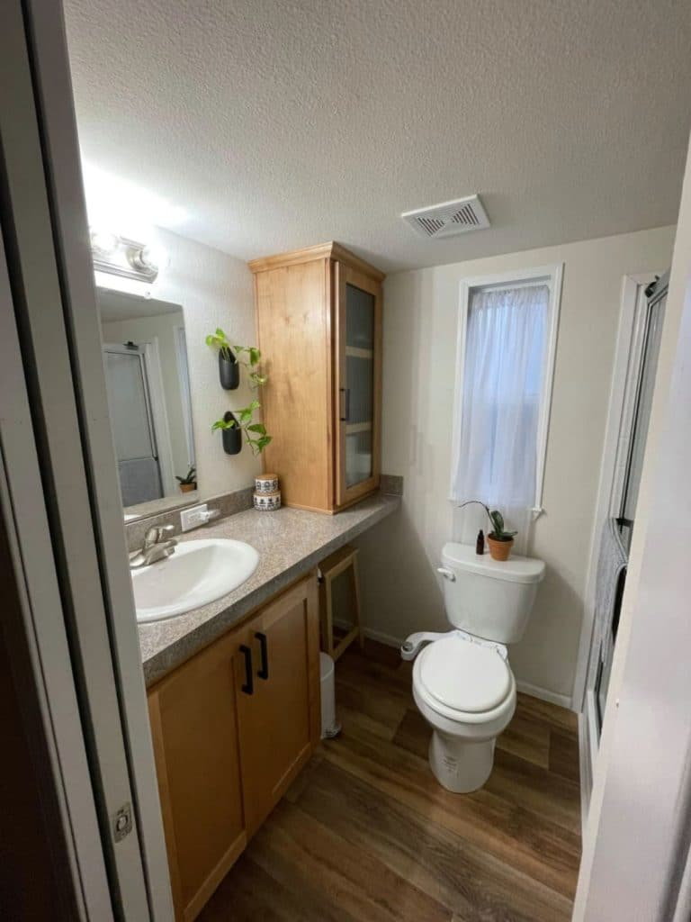 Bathroom with wood cabinets and shelving