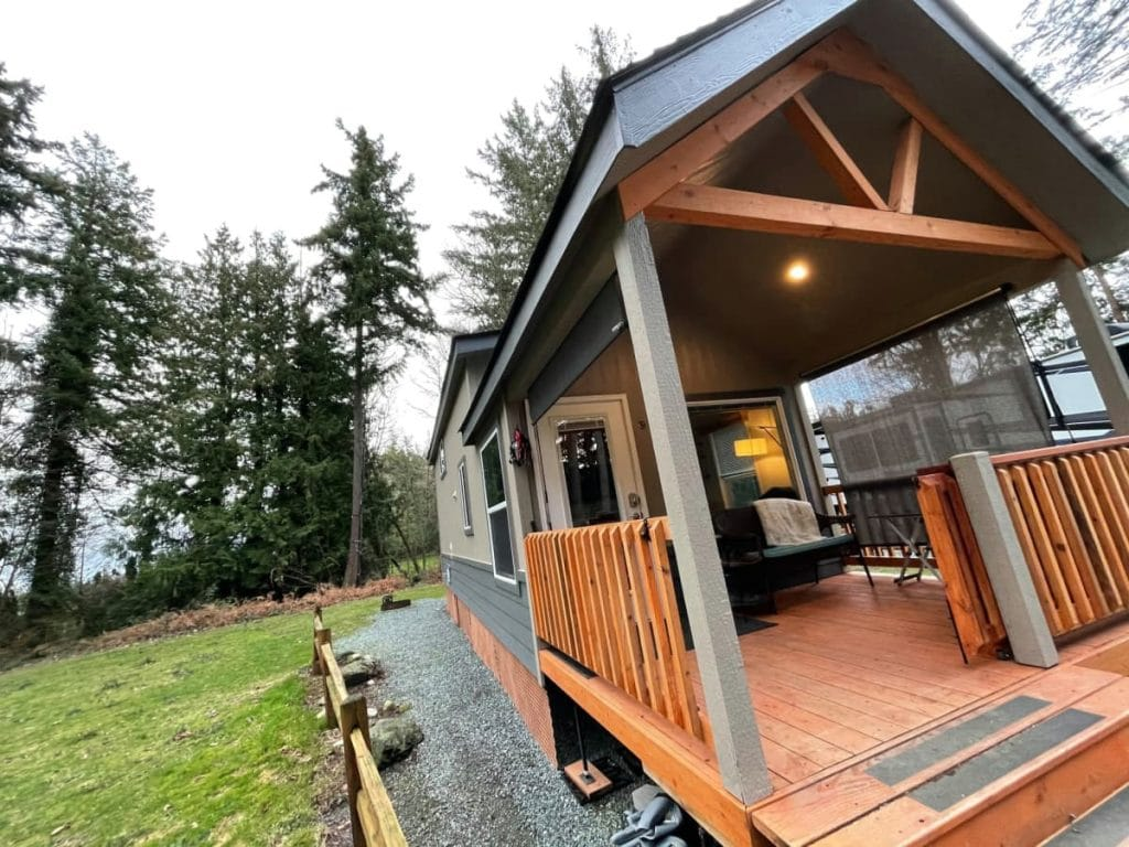 Covered porch on front of tiny home in lot
